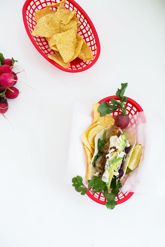 tacos and tortilla chips in red baskets / sfgirlbybay