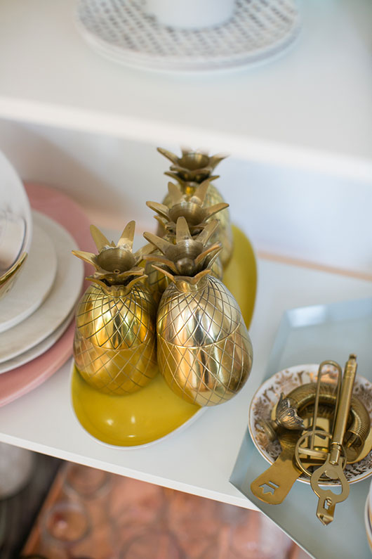 golden pineapples and dishware in downtown la loft / sfgirlbybay