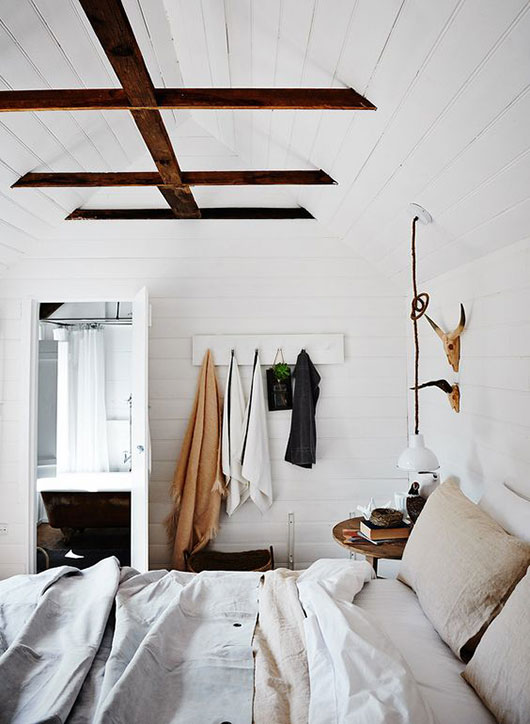 bedroom with wood beamed ceiling at the estate trentham / sfgirlbybay