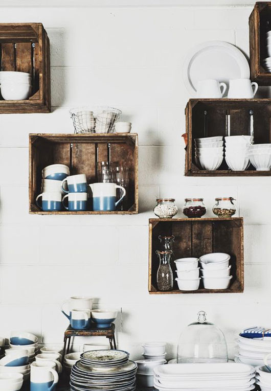 blue and white dishware and crate wall storage in kitchen via apartment therapy / sfgirlbybay