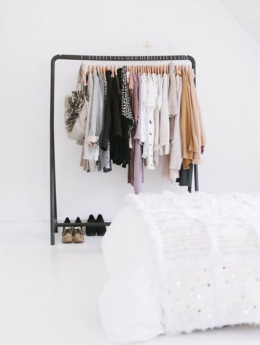 thick black clothing rack in white bedroom / @sfgirlbybay