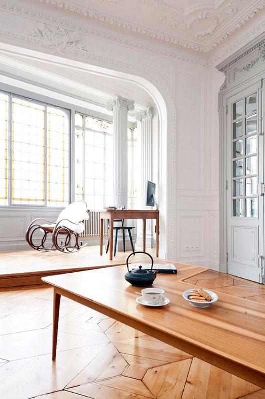 modern wood furnishings in paris penthouse with ornate crown mouldings / sfgirlbybay