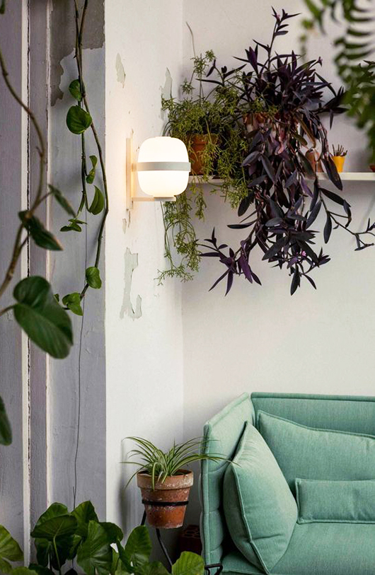 indoor plants with modern sconce and mint sofa via yellowtrace. / sfgirlbybay
