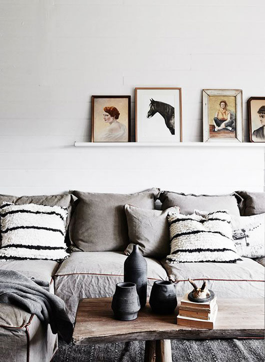 low gray sofa with striped throw pillows via gardener & marks interiors. / sfgirlbybay