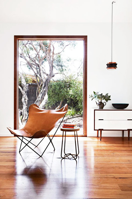 tan leather butterfly chair via desire to inspire. / sfgirlbybay