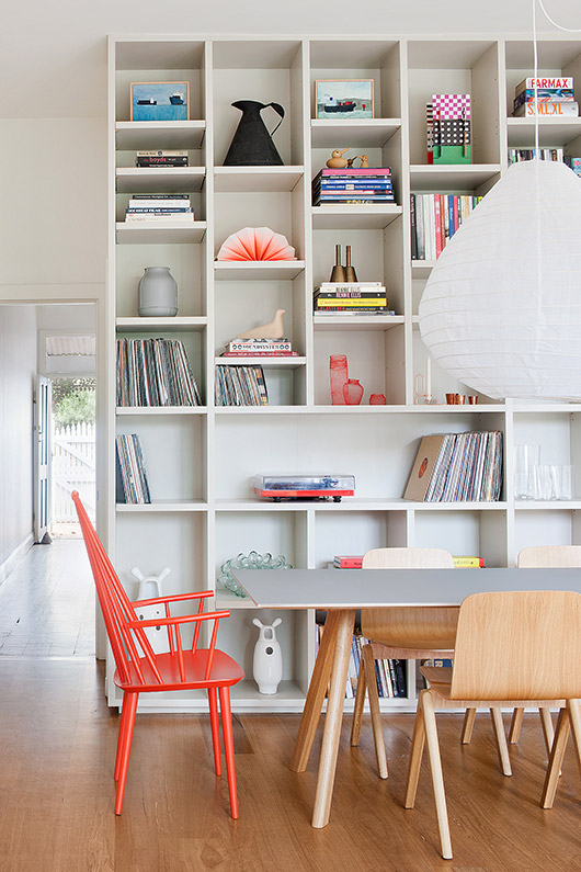 white built-in bookshelves with colorful decor by made by cohen / sfgirlbybay