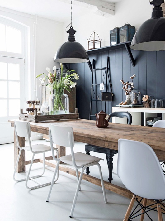black industrial lights with black wall in modern barn house with white walls and mismatched white chairs. / sfgirlbybay