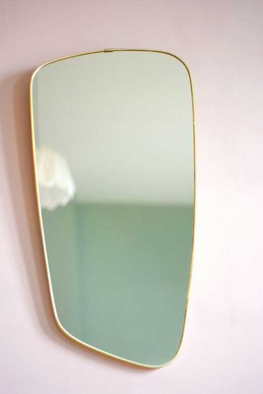 gold rimmed F.A.33 mirror on pale pink wall / sfgirlbybay