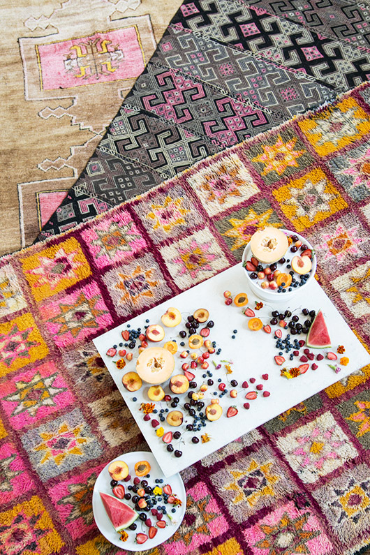 colorful moroccan rugs styled for indoor picnic to celebrate abc carpet and home's summer sale / sfgirlbybay
