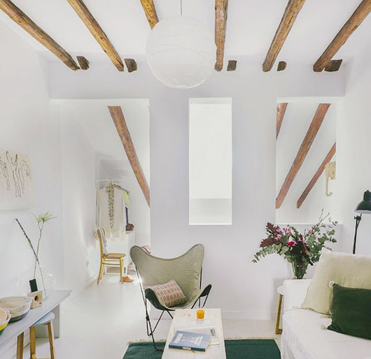 modern furnishings in loft with white walls and floor and exposed beamed ceilings in spain / sfgirlbybay