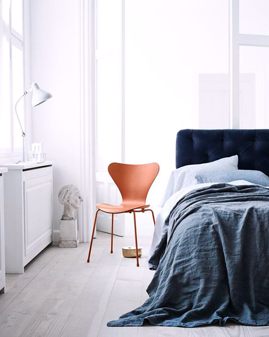 tall modern white bedroom with cool blues and hints of bright orange / sfgirlbybay