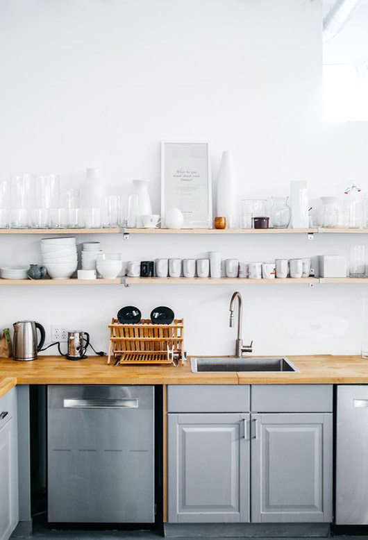 simple gray and white and wood kitchen in the everlane studio space / sfgirlbybay