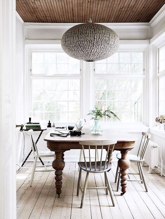 pendant lantern light fixture in sun room with dning table and chairs / sfgirlbybay