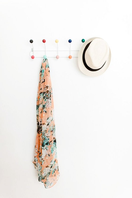 white wall with colorful mid-century modern coat rack / sfgirlbybay