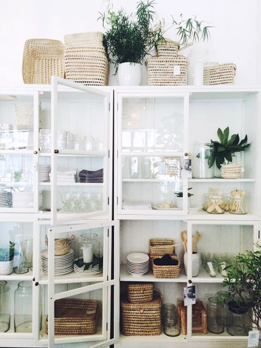 stacked white, glass-front cabinets / sfgirlbybay
