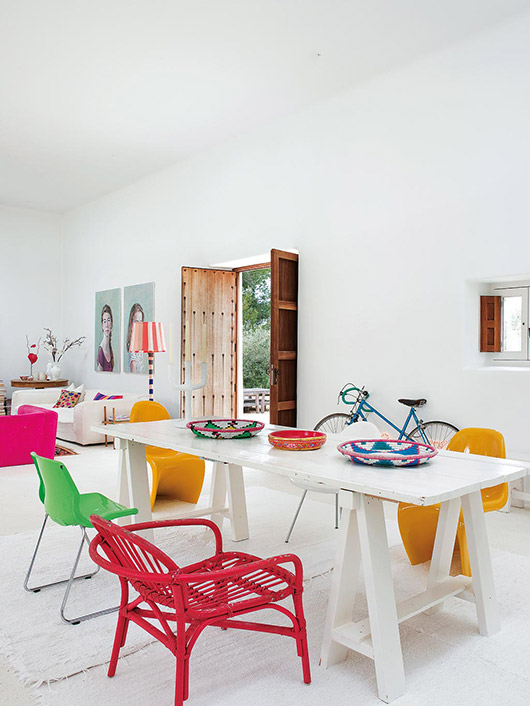 home with white walls and colorful decor / sfgirlbybay