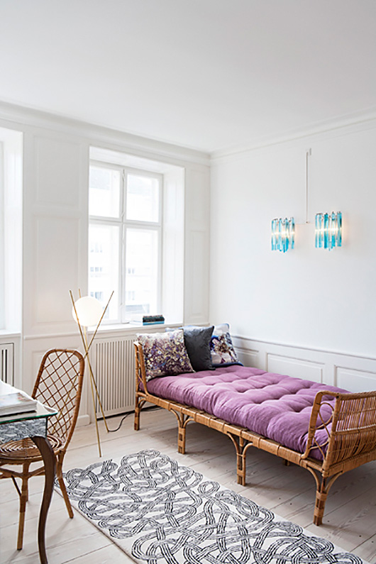 rattan daybed and desk chair in apartment denmark / sfgirlbybay