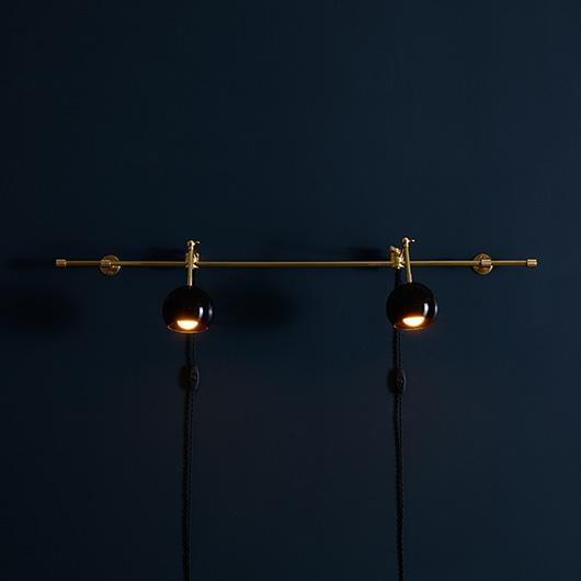 katy skelton lighting on dark blue wall. / sfgirlbybay