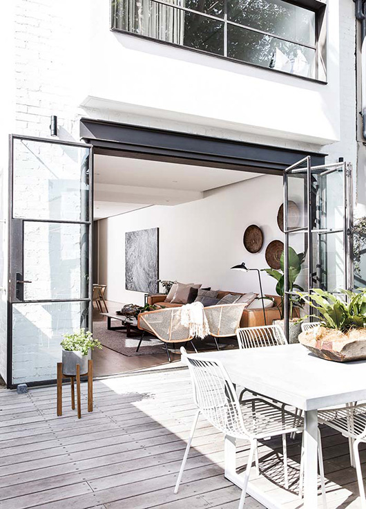 steel and glass doors to patio in modern home featured by inside out magazine. / sfgirlbybay