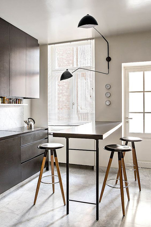 minimalist kitchen with serge mouille wall sconce / sfgirlbybay