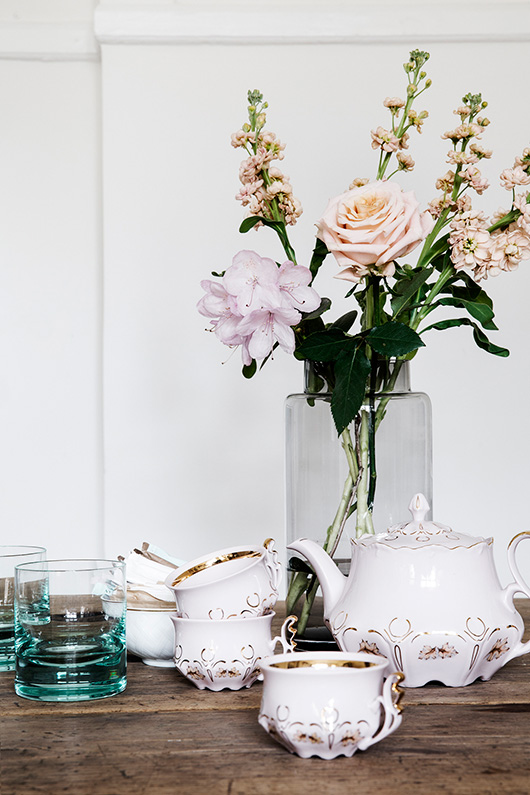 ceramics and glassware with flowers photographd by line klein / sfgirlbybay