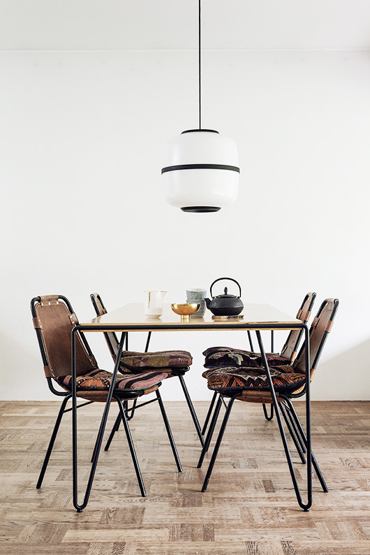 bohemian modern dining table and chairs with black and white pendant lamp / sfgirlbybay