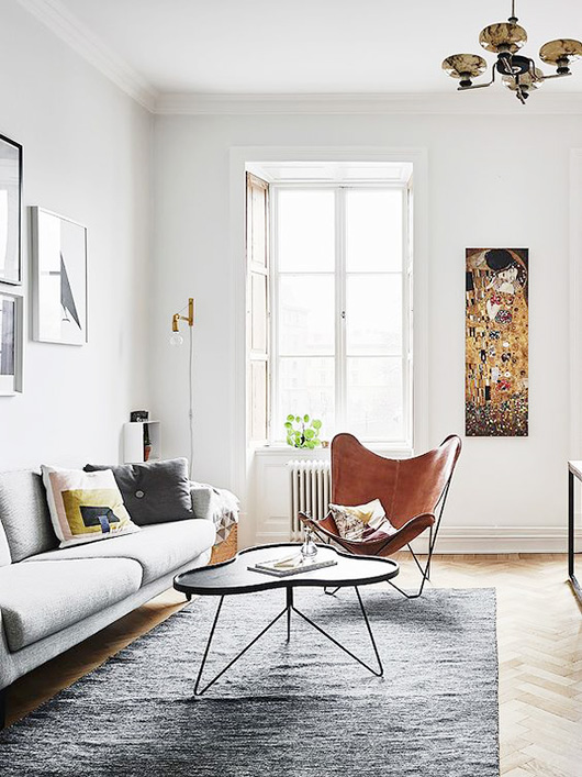 leather butterfly chair in modern living room / sfgirlbybay