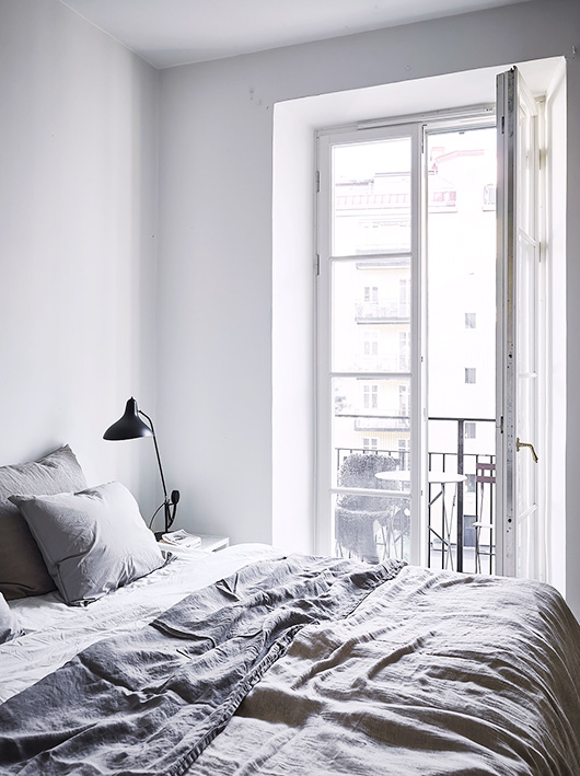 white bedroom with gray bed linens. / sfgirlbybay