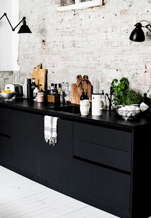dark kitchen cabinets and exposed brick walls / sfgirlbybay