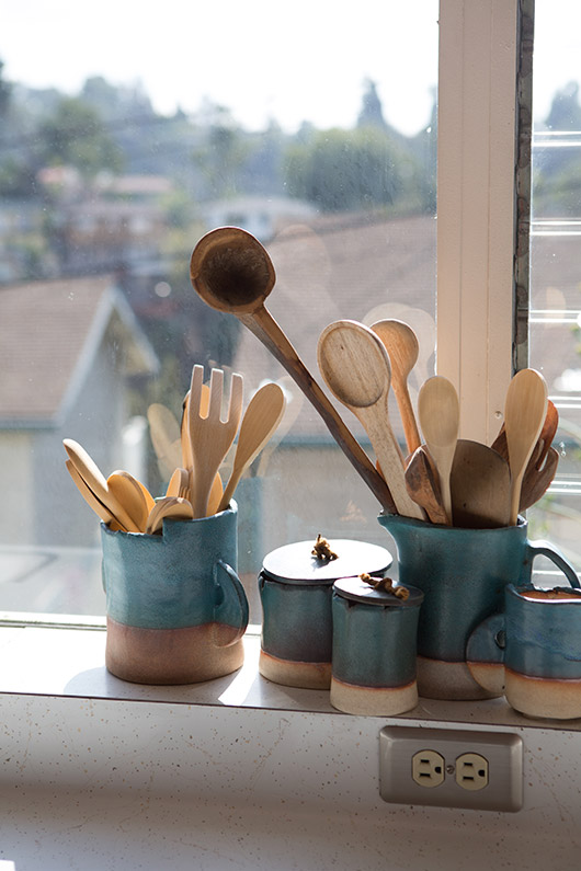 ceramic pottery filled with kitchen utensils. / sfgirlbybay