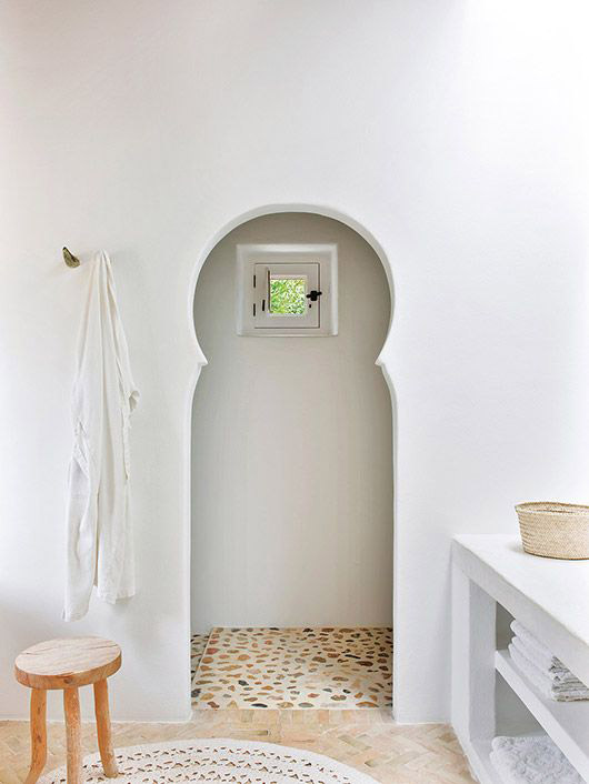 arched shower door in minimalist bathroom. / sfgirlbybay