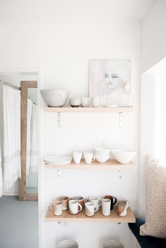 open shelving with white dishware. / sfgirlbybay