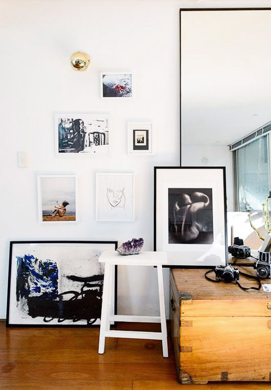 simple gallery wall with framed prints hung and leaned against wall. / sfgirlbybay