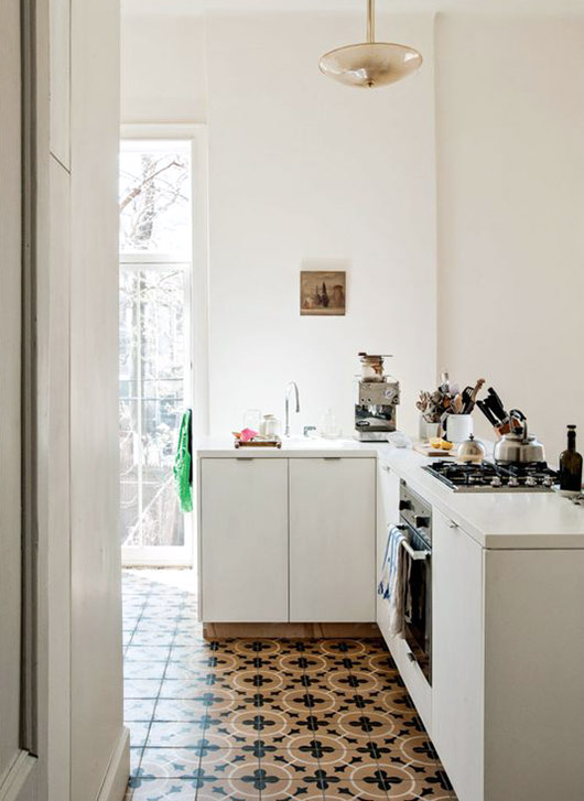 minimalist white kitchen with patterned floor tiling / sfgirlbybay