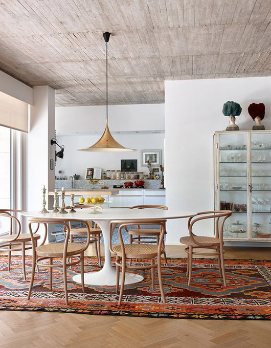 bentwood dining chairs around white tulip style table. / sfgirlbybay