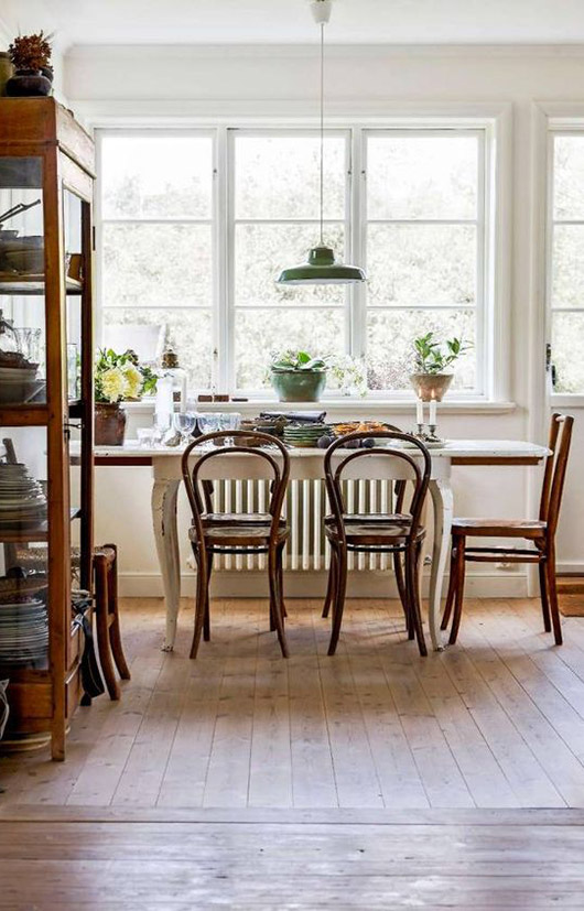 mismatched bentwood chairs. / sfgirlbybay