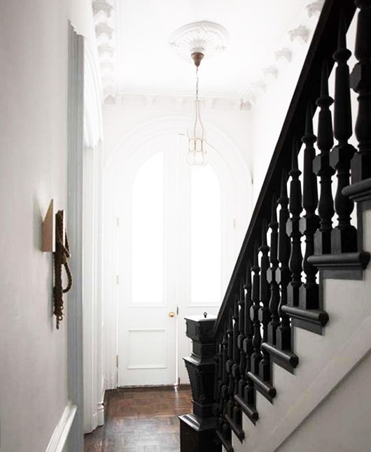 black wood staircase and white walls. / sfgirlbybay