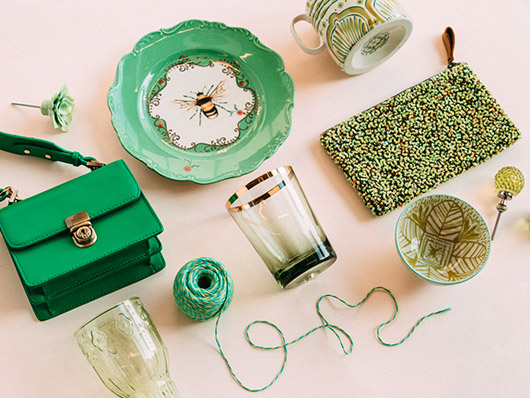 green accessories on pink backdrop. / sfgirlbybay