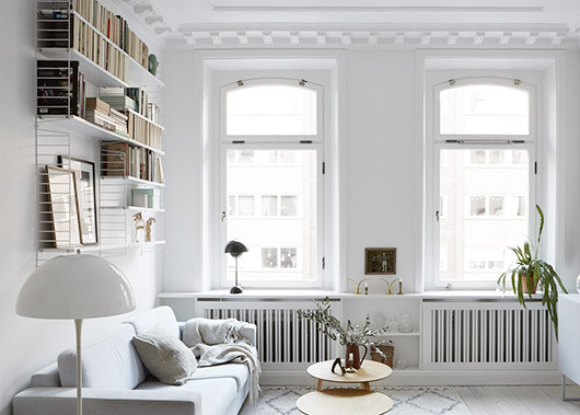 white living room with books and black accents via fantastic frank. / sfgirlbybay