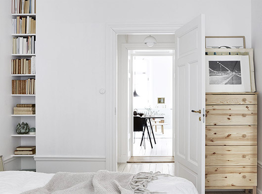 exposed wood dresser and book storage in white bedroom via fantastic frank. / sfgirlbybay