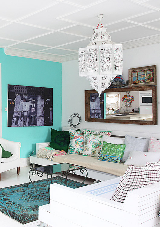 aqua accent wall and vintage home furnishings via light locations london. / sfgirlbybay