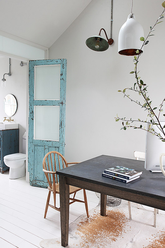 rustic blue door between bathroom and dining room. / sfgirlbyaby