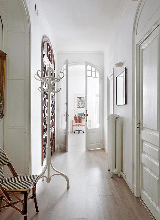 arched hallway doors in the home of interior designers A & B curated. / sfgirlbybay