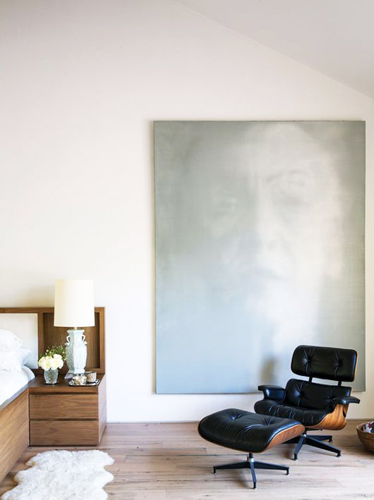 black eames lounge chair and ottoman and oversized painting. / sfgirlbybay