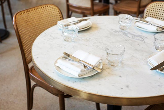 gold trimmed marble table with bentwood chairs. / sfgirlbybay