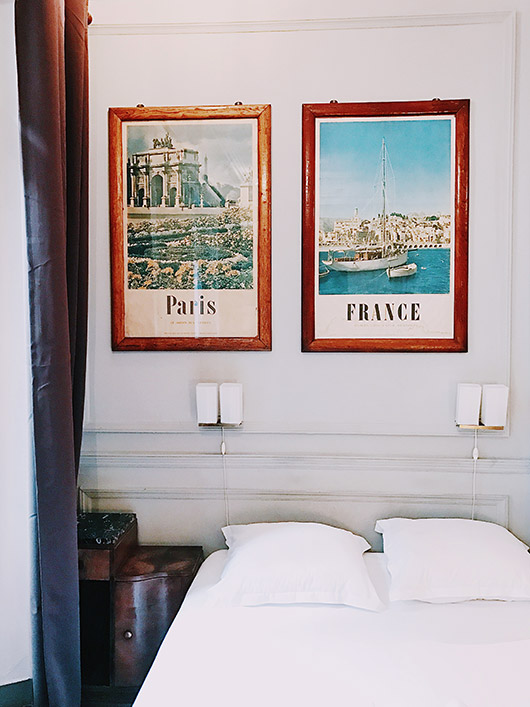 framed vintage posters in my hotel in france. / sfgirlbybay