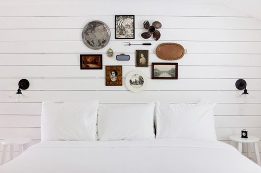 white bedroom with rustic wall decor. / sfgirlbybay