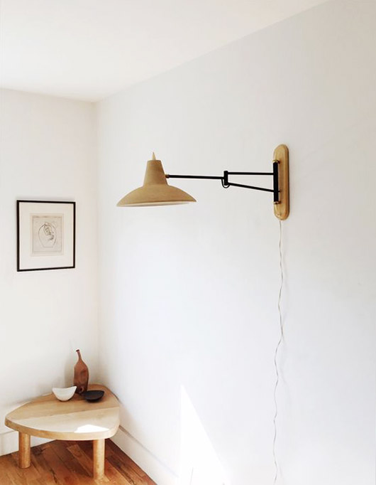 white walls with art and modern light fixture. / sfgirlbybay