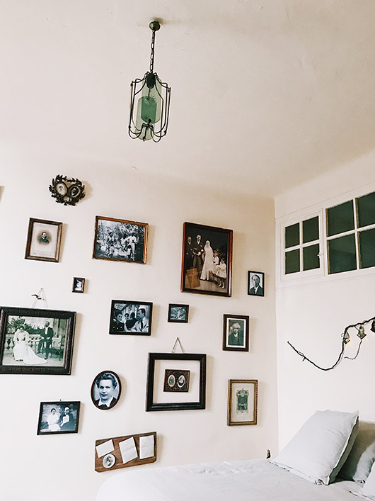 wall of vintage portraits at maison empereur. / sfgirlbybay