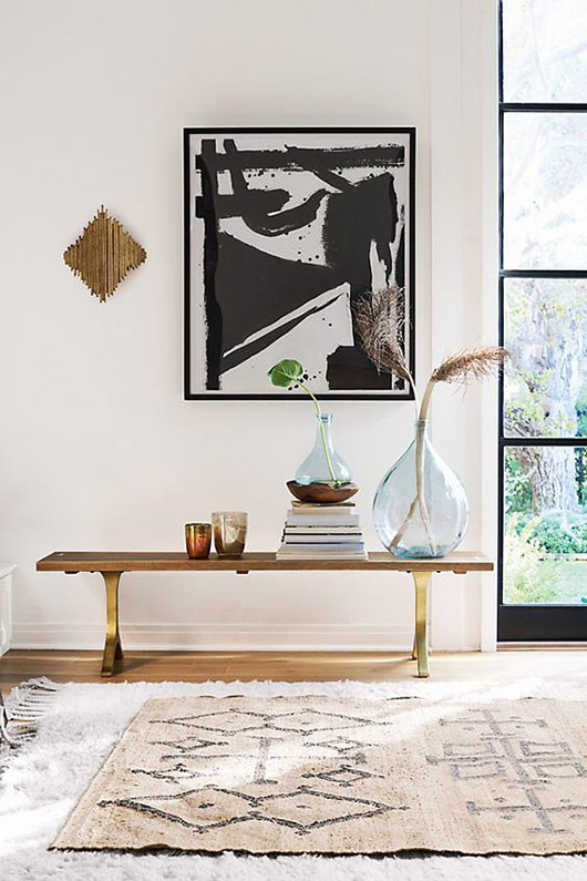 black and white framed art print and gold wall sconce. / sfgirlbybay